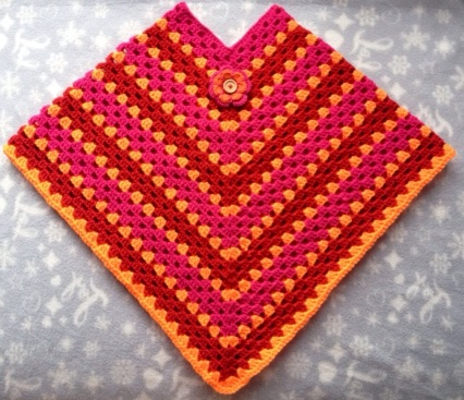 poncho rose-oranje-rood kind