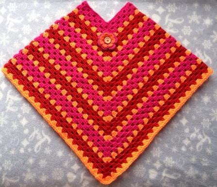 poncho rose-oranje-rood kind